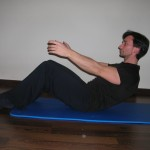 Pilates roll down 2